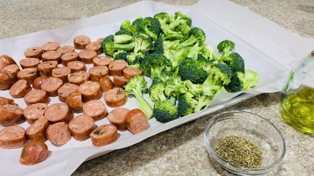 Sliced Chicken Sausage and Broccoli on Sheet Pan